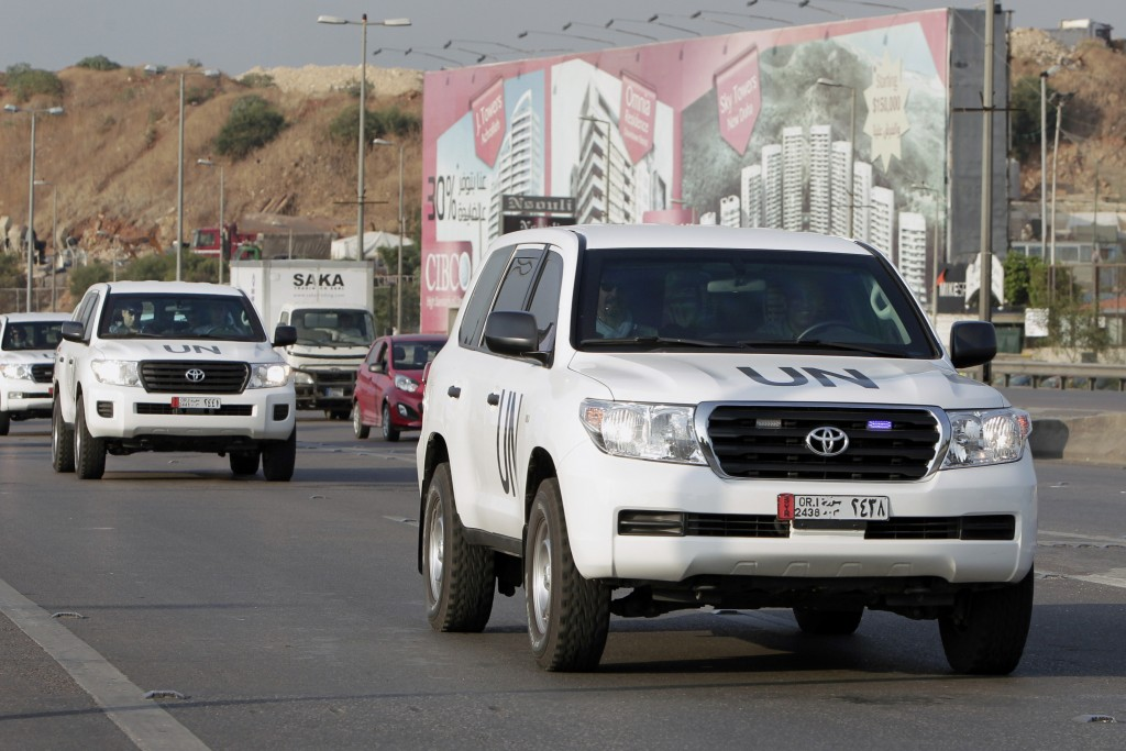 The convoy of a U.N. team of weapons inspectors arrive at the airport in Beirut on Monday to catch a plane to Syria, where they will oversee chemical weapons destruction.