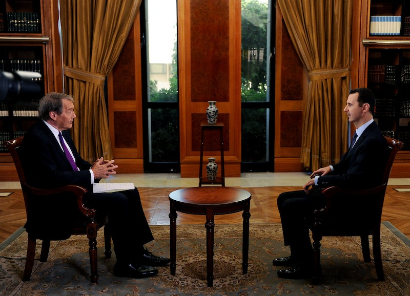 In this Sunday, Sept. 8, 2013 photo released by the Syrian official news agency SANA, PBS host Charlie Rose, left, interviews Syrian President Bashar Assad at the presidential palace in Damascus, Syria. In an interview broadcast Monday, Sept. 9, 2013 on