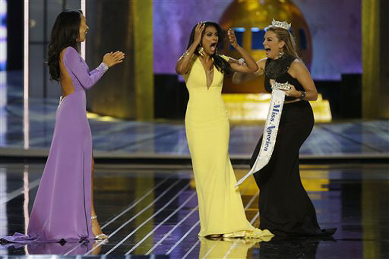 Miss New York Nina Davuluri, center, reacts Sunday after being named Miss America 2014 as Miss California Crystal Lee, left, and Miss America 2013 Mallory Hagan celebrate with her.
