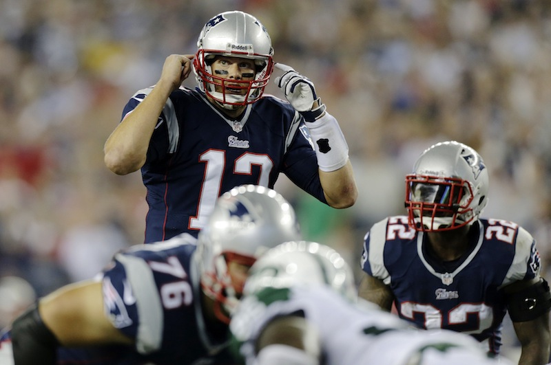 New England Patriots quarterback Tom Brady gestures at the line of scrimmage during the first quarter against the New York Jets in Foxborough, Mass., on Sept. 12. Tampa Bay can't close out games, losing twice already on last-second field goals. New England can't seem to find the magic on offense, yet has pulled out two close victories. When the Bucs visit the Patriots on Sunday, it will be a study in contrasts.