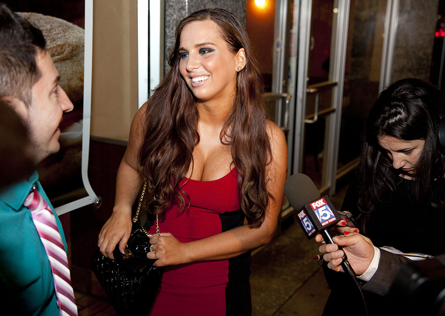 Sydney Leathers, who engaged in online sex chats with Democratic mayoral hopeful Anthony Weiner last summer, tries to enter his election gathering place at Connolly's Pub in midtown Tuesday, September 10, 2013 in New York. Weiner surprisingly entered the race in May after being in political exile since resigning from Congress in 2011 upon admitting to lewd online exchanges with women who were not his wife. (AP Photo/Jin Lee)