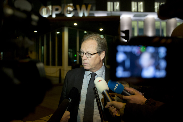 Spokesman Michael Luhan gives a brief statement outside the headquarters of the Organization for the Prohibition of Chemical Weapons in The Hague, Netherlands, on Friday. The global chemical weapons watchdog has scheduled a meeting to approve a U.S.- and Russian-brokered plan to rapidly verify, secure and then destroy Syria's arsenal of poison gas and nerve agents.
