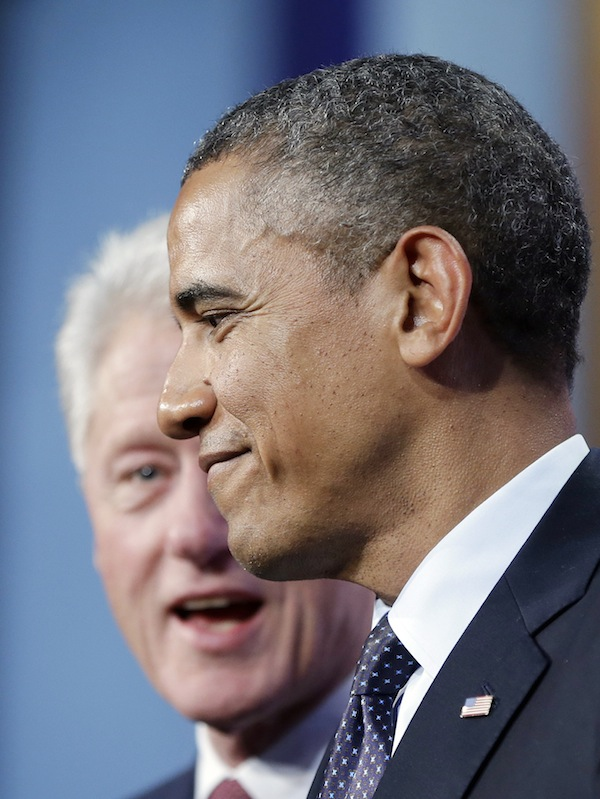 President Barack Obama, right, on stage with former President Bill Clinton, left, after speaking at the Clinton Global Initiative in New York, Tuesday, Sept. 24, 2013. (AP Photo/Pablo Martinez Monsivais)
