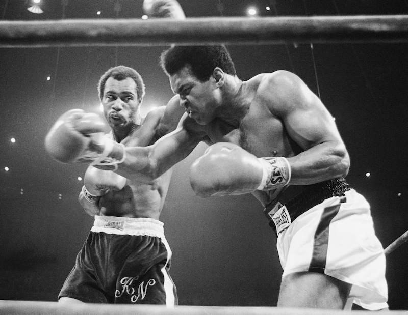 In this Sept. 10, 1973, file photo, Muhammad Ali, right, winces as Ken Norton hits him with a left to the head during their re-match at the Forum in Inglewood, Calif. Norton, a former heavyweight champion, has died, his son said, Wednesday, Sept. 18, 2013. He was 70. (AP Photo/File) Competition Challenge Boxing Ring Aggression Action Boxing Glove