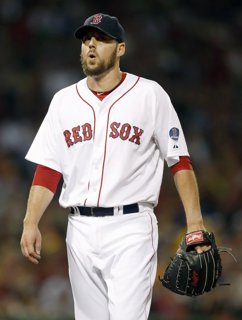 Red Sox pitcher John Lackey walks to the dug out after retiring the Baltimore Orioles in the third inning Thursday.
