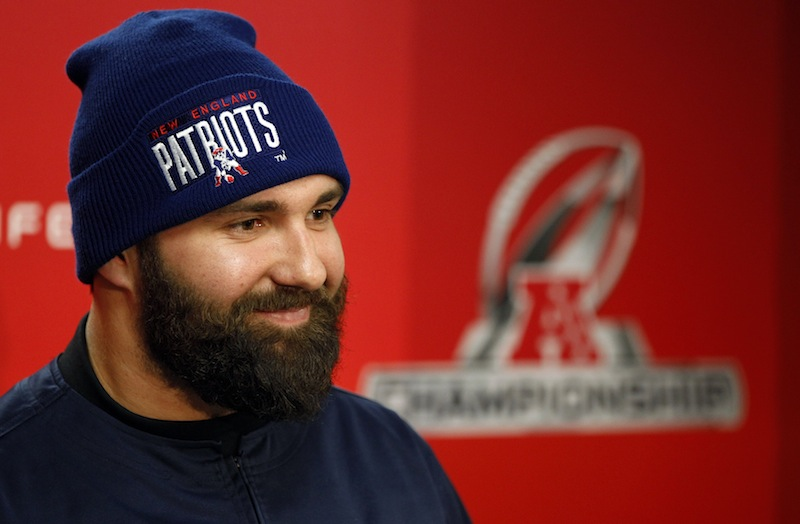 In this January 2013 file photo, New England Patriots defensive end Rob Ninkovich (50) smiles as he responds to a reporter's question. Ninkovich has signed a three-year, $15 million extension with the Patriots, the team announced Monday, Sept. 23, 2013. (AP Photo/Stephan Savoia)