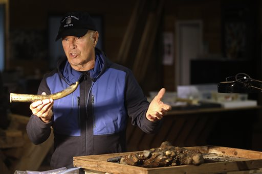Explorer Barry Clifford holds the barrel of a partially crushed blunderbuss he salvaged from the wreck of pirate ship Whydah.