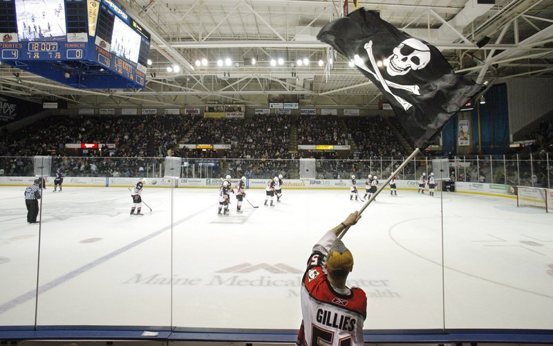 In this 2010 file photo, Dan Bailey of Yarmouth waves the Jolly Roger during a game between the Portland Pirates and Manchester Monarchs at the Cumberland County Civic Center. The Cumberland County Civic Center's trustees and the owner of the Portland Pirates are headed to court after failing to reach an agreement on a lease that would keep the American Hockey League team playing at the arena for at least five more years.