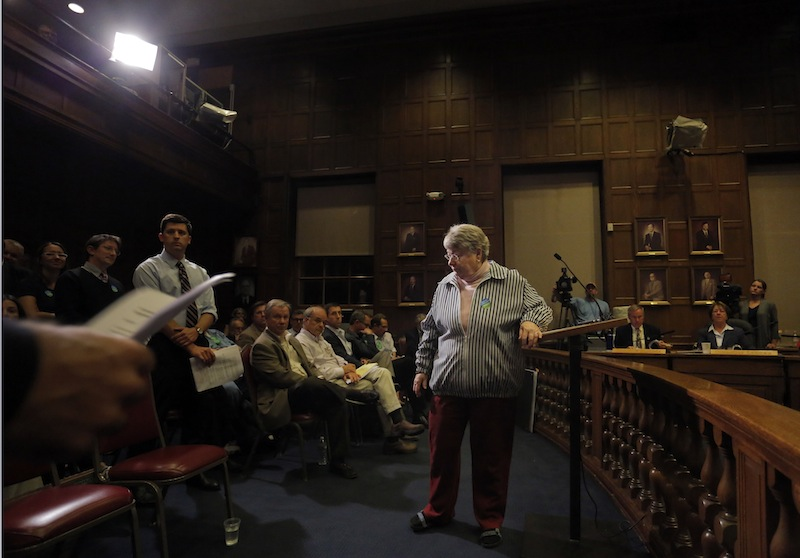 Bonnie Johnstone of Portland leaves the podium at the Portland City Council chambers after speaking in opposition to the sale of Congress Square Monday, September 9, 2013.