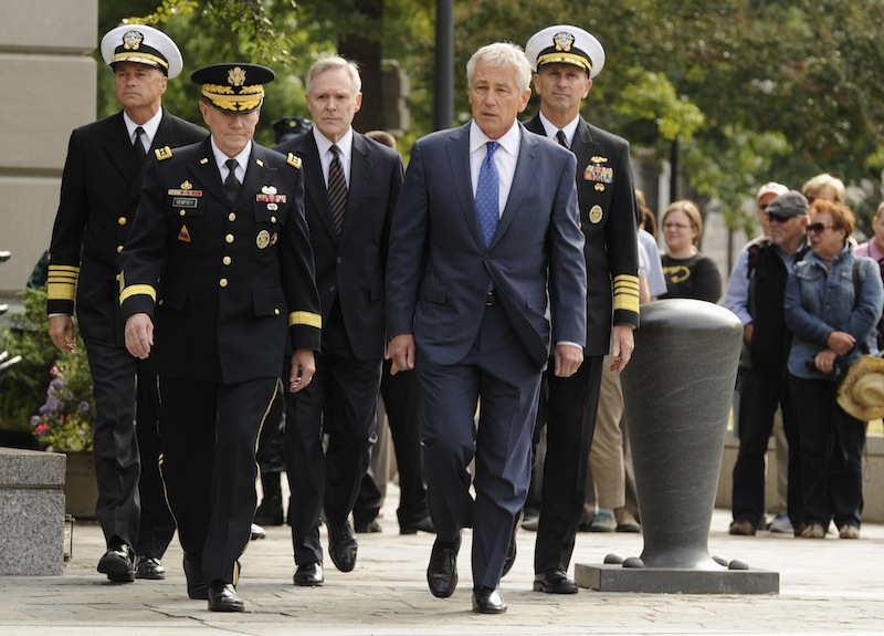 From L-R: Vice Chairman of the Joint Chiefs Adm. Sandy Winnefeld, Chairman of the Joint Chiefs Gen. Martin Dempsey, Navy Secretary Ray Mabus, Defense Secretary Chuck Hagel and Chief of Naval Operations Adm. Jonathan Greenert arrive at a ceremony at the Navy Memorial in Washington, honoring the victims of an attack at the Navy Yard, at the Navy Memorial in Washington, September 17, 2013. Washington authorities questioned on Tuesday how a U.S. military veteran with a history of violence and mental problems could have gotten clearance to enter a Navy base where he killed 12 people before police shot him dead. (REUTERS/Mike Theiler) :rel:d:bm:GF2E99H15H001