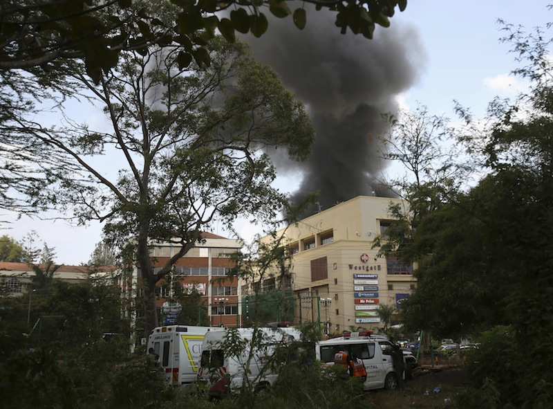 Smoke rises over Westgate shopping centre after an explosion in Nairobi, September 23, 2013. A day after a Twitter post linked Maine to Saturday's terrorist attack in a mall in Nairobi, Kenya, law enforcement officials refused to say whether they are investigating the possibility that radical Islamist groups are trying to recruit new members in the state. (REUTERS/Karel Prinsloo) :rel:d:bm:GF2E99N0YU901
