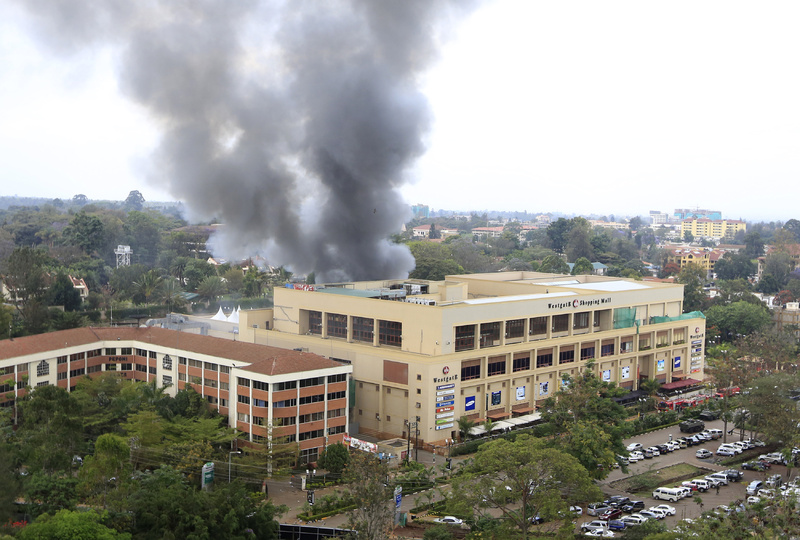 Smoke rises from the Westgate shopping center after explosions at the mall in Nairobi on Monday. :rel:d:bm:GF2E99N14UF01