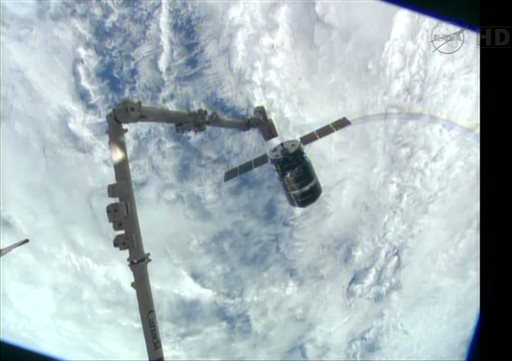 This framegrabbed image provided by NASA-TV shows the Cygnus spacecraft as it approaches the International Space Station Sunday. The Canadarm 2 which will grapple the spacecraft can be seen lower left.
