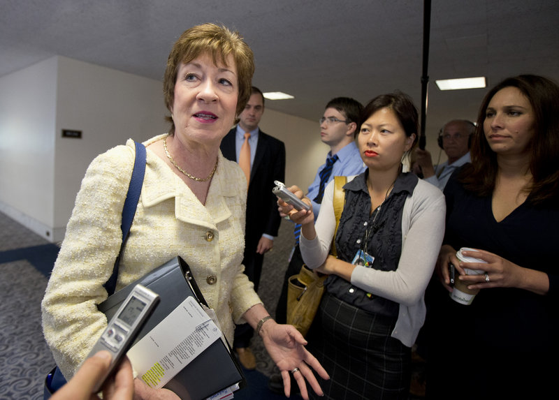 Senate Intelligence Committee member Sen. Susan Collins, R-Maine, talks to reporters on Capitol Hill in Washington, Thursday, Sept. 5, 2013, as she arrives for a closed-door briefing on Syria. (AP Photo/Manuel Balce Ceneta)