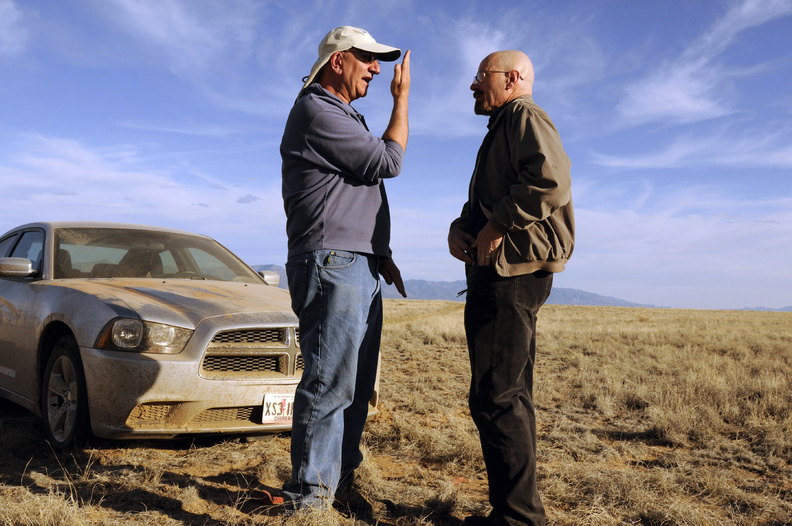 Cinematographer Michael Slovis, left, and Bryan Cranston work on the set of