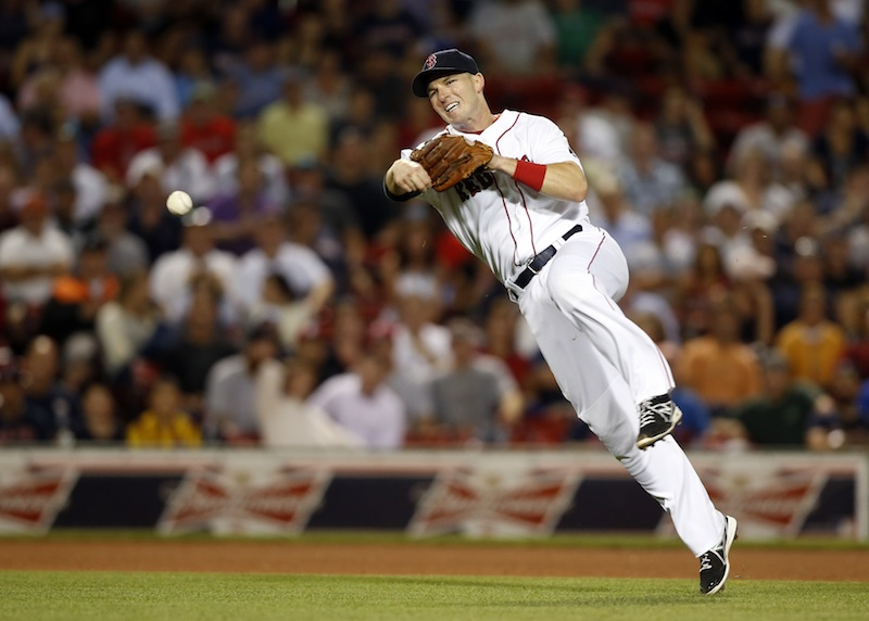 Red Sox shortstop Stephen Drew throws out Detroit Tigers' Torii Hunter after fielding his grounder during the seventh inning Tuesday night.