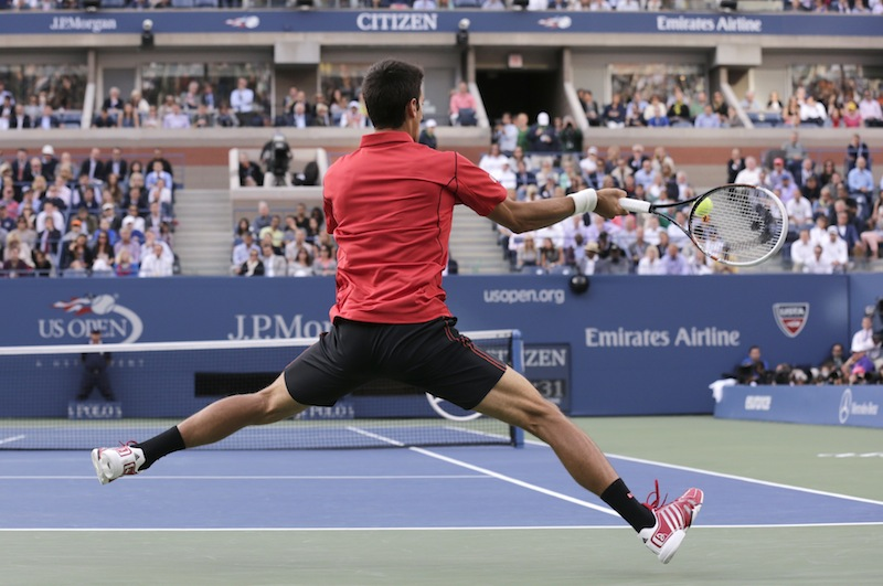 Novak Djokovic, of Serbia, returns a shot to Rafael Nadal, of Spain, during the men's singles final of the 2013 U.S. Open tennis tournament, Monday, Sept. 9, 2013, in New York. (AP Photo/Charles Krupa)
