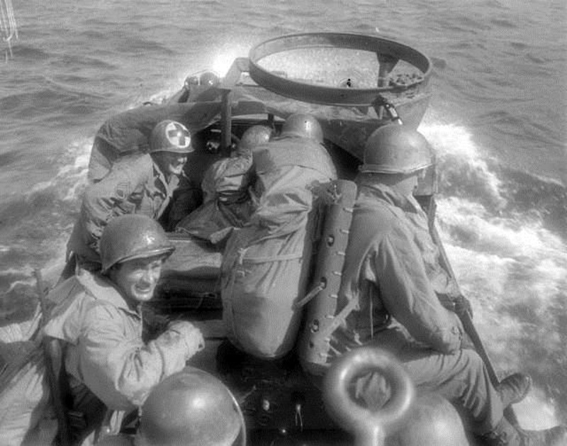 In this historic image, an American amphibious vehicle crosses an Italian lake during World War II. A volunteer group's discovery of what could be the wreckage of such a vehicle 900 feet below the surface of Italy's Lake Garda has given aging veterans hope that, after nearly seven decades, the remains of their comrades can finally be brought home for a proper burial.