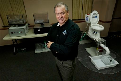 Rob Villee, executive director of the Plainfield Area Regional Sewer Authority in New Jersey, poses with his test equipment in his office in Middlesex, N.J. Increasingly popular bathroom wipes, thick, premoistened towelettes that are advertised as flushable, are creating clogs and backups in sewer systems around the nation. The problem has gotten so bad in this upstate New York town that frustrated sewer officials traced the wipes back to specific neighborhoods, and even knocked on doors to break the embarrassing news to residents that they are the source of a costly, unmentionable mess.