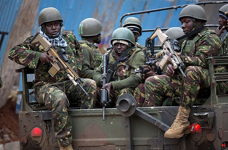Trucks of soldiers from the Kenya Defense Forces arrive after dawn outside the Westgate Mall in Nairobi, Kenya on Sunday. Islamic extremist gunmen lobbed grenades and fired assault rifles inside Nairobi's top mall Saturday, killing dozens and wounding over a hundred in the attack. Early Sunday morning, 12 hours after the attack began, gunmen remained holed up inside the mall with an unknown number of hostages.