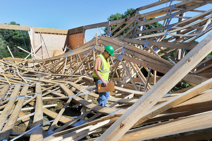 Windham code enforcement inspector Wayne Mathews looks over the damage to the arena on Wednesday.