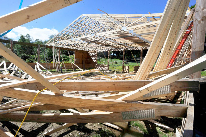 Most of the collapsed arena being built on the Nash Road in Windham remained intact but about half of the roof will need to be rebuilt.