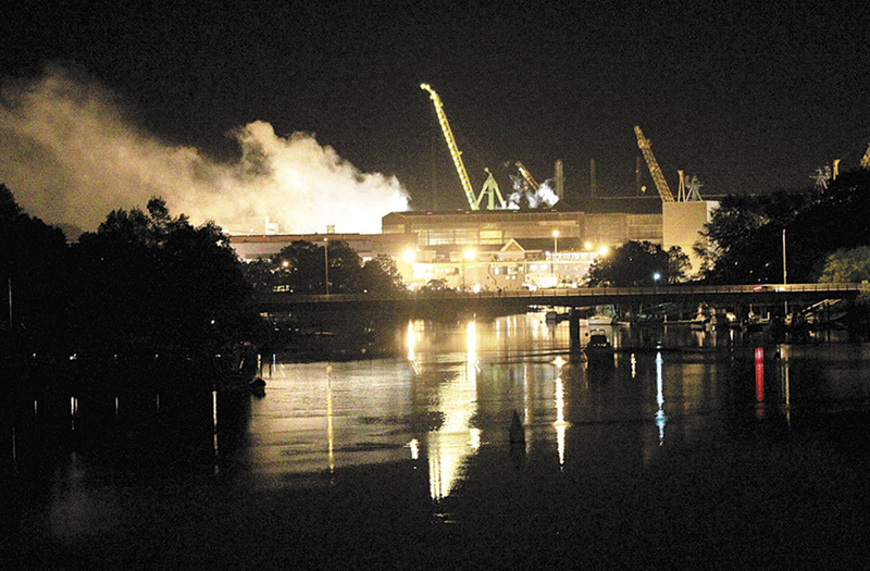 Smoke rises from a Portsmouth Naval Shipyard dry dock as fire crews respond Wednesday, May 23, 2012 to a fire on the USS Miami SSN 755 submarine at the Portsmouth Naval Shipyard on an island in Kittery, N.H. Four people were injured. (AP Photo/The Herald, Ionna Raptis)