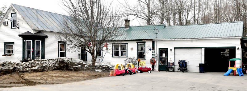 In this March 2013 file photo, children's toys can be seen outside the ABC 123 Daycare shortly after kids went back inside on Upper Main Street in Norridgewock, Maine. The owners of the daycare, which was shut down after four children were molested, are now facing a civil lawsuit filed by the Maine Department of Health and Human Services on behalf of one of the children.