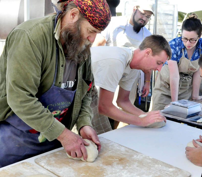 Dusty Dowse, left, and other bakers prepare dough Thursday for 500 loaves of rye bread to feed volunteers at the upcoming three-day Common Ground Country Fair in Unity. Others making bread from left are Jeff Dec, Lily Joslin and Dan Rivera, in background.