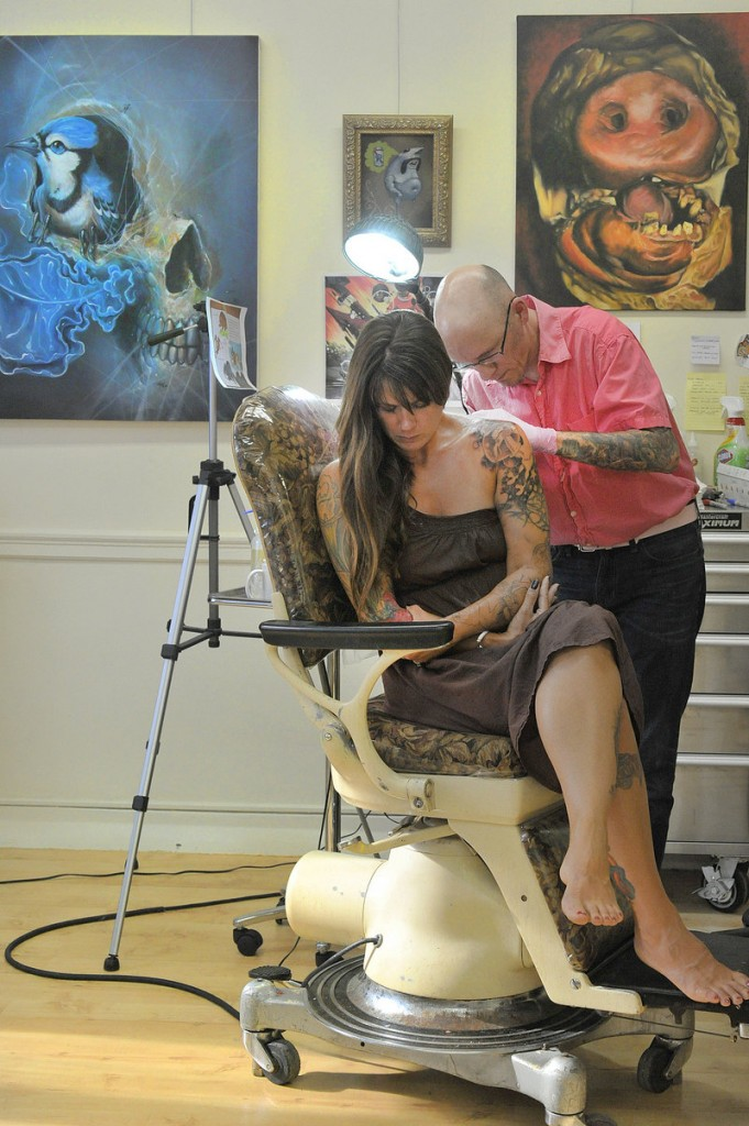 Chris Dingwell at work on a tattoo for Jen Parker of Brattleboro, Vt., at his Chris Dingwell Studio.