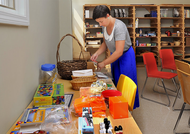 Elementary teacher Kimberly Jordan organizes materials as she prepares for opening day at the Fiddlehead School of Arts & Sciences in Gray.