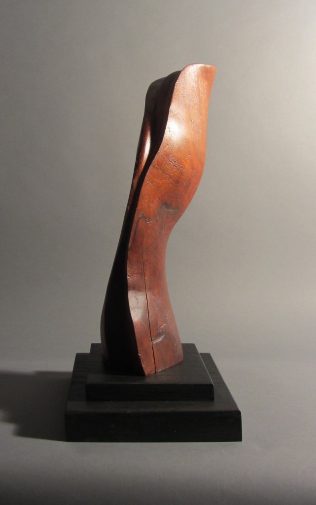 """""""Abstract Form"""" by Robert Laurent, c. 1915, carved wood on a separate wood base."""