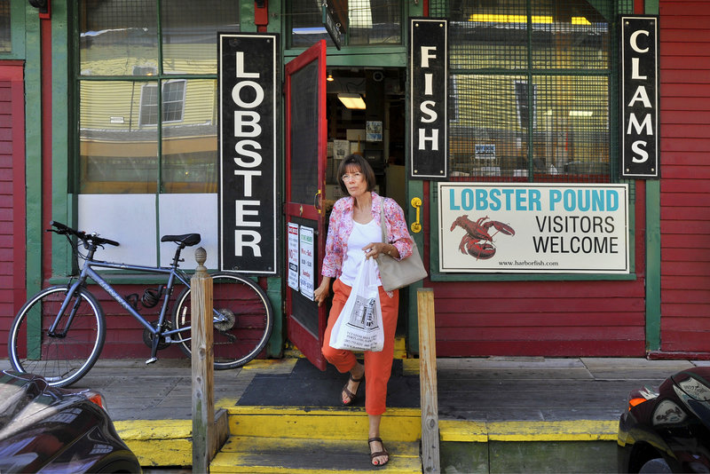 Alice Hamilton of Scarborough, a regular, exits the Harbor Fish Market.