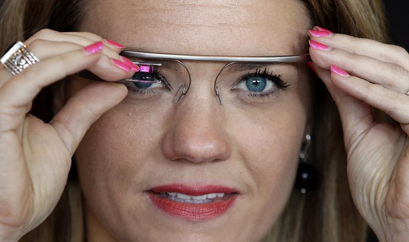 """Sarah Hill, a Google Glass contest winner, tries out the device. """"This is like having the Internet in your eye socket,"""" Hill said. """"But it's less intrusive than I thought it would be. I can totally see how this would still let you still be in the moment with the people around you."""""""