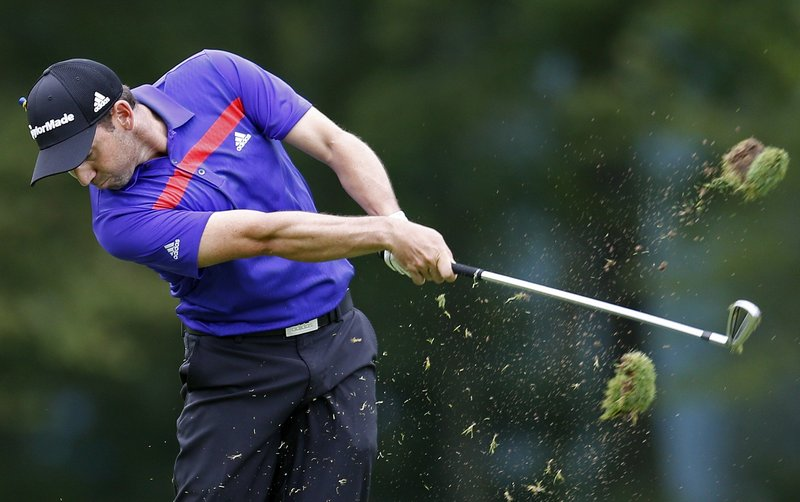Sergio Garcia hits from the fairway on the fifth hole Sunday during the third round of the Deutsche Bank Championship in Norton, Mass. Garcia opened a two-stroke lead over Henrik Stenson, using five birdies on the back nine to shoot a 65.