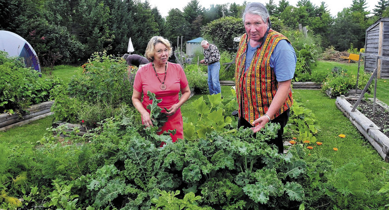 Connie Bellet and her husband, Phillip Frizzell, work in the Palermo Community Garden on Sunday. A lawyer representing the Legion now says there will be no bulldozers Monday.
