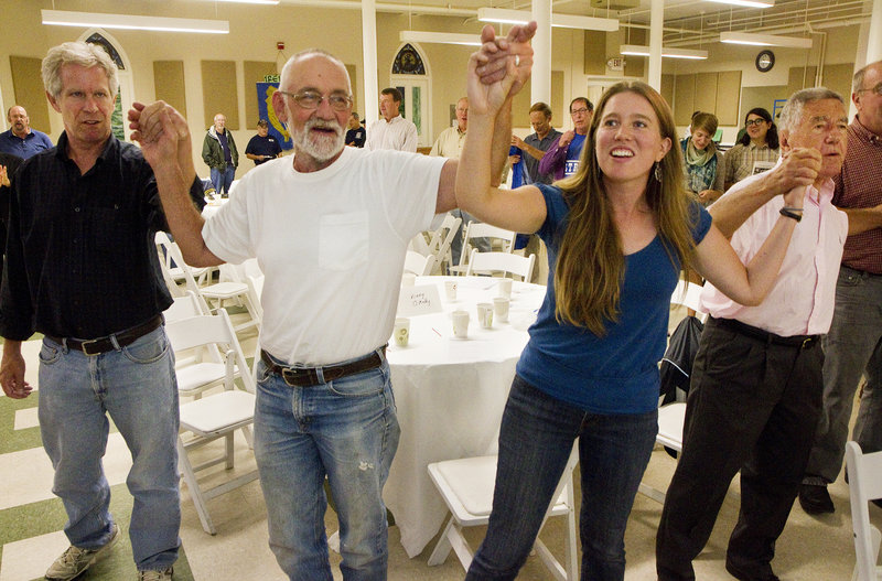 """People at the Southern Maine Labor Council's Labor Day breakfast sing """"Solidarity Forever."""" From left are Ned McCann of Portland, Peter Kellman of North Berwick, Sarah Bigney, AFL-CIO staff from Hallowell, and Charles Scontras of Cape Elizabeth."""