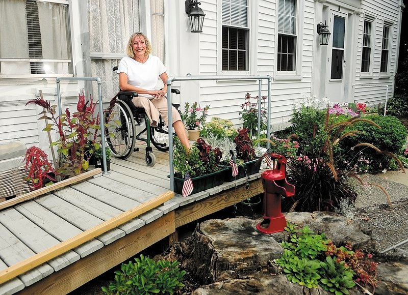 "Ann Lindholm is shown at her Winthrop home. She says that in order to emerge from the pain of facing an amputation, ""You can't make it through without becoming stronger in all ways."""