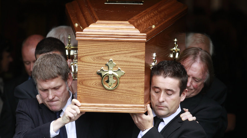 Family members carry the coffin of celebrated poet Seamus Heaney from Dublin's Church of the Sacred Heart on Monday.