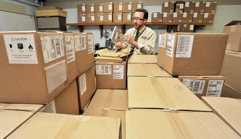 Andrew Wallace, director of technology for South Portland schools, has his team preparing more than 1,500 iPads for students. The iPad didn't exist when the state last bought computers for schools, in 2009. Other Maine districts selected Apple MacBook Air laptops.