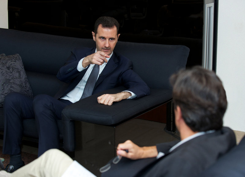 Syrian President Bashar Assad gestures during an interview with the French daily newspaper Le Figaro on Monday.