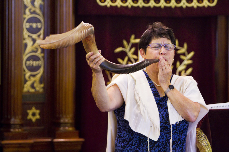 With the Jewish holiday of Rosh Hashanah beginning Wednesday, Rabbi Carolyn Braun plays a Shofar, (a horn-like instrument made from a bovine horn) part of a 30-minute ceremony at The Cedars retirement community in Portland on Wednesday, Sept. 4, 2013.