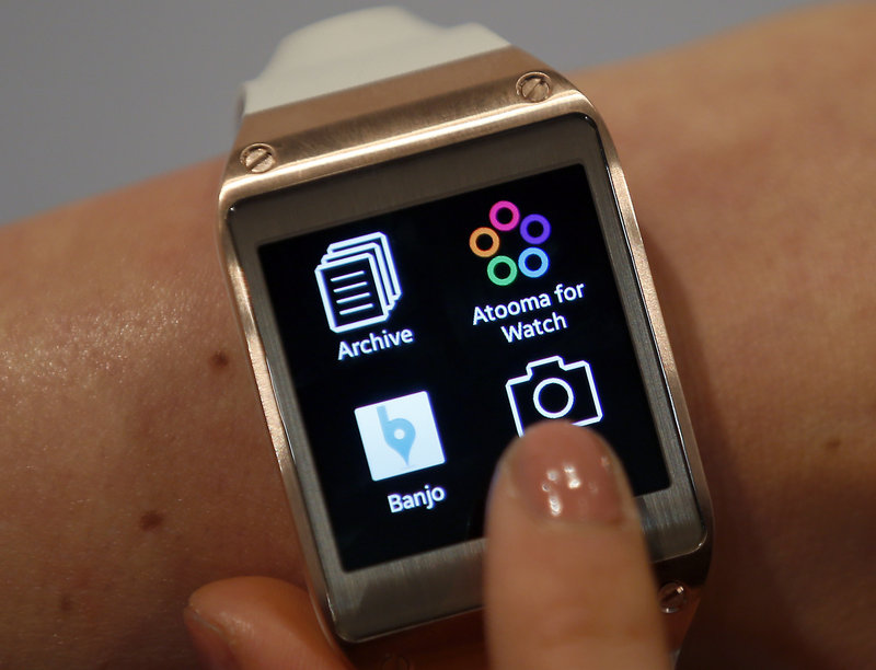A Samsung Galaxy Gear digital watch works through a wireless link with the user's smartphone.