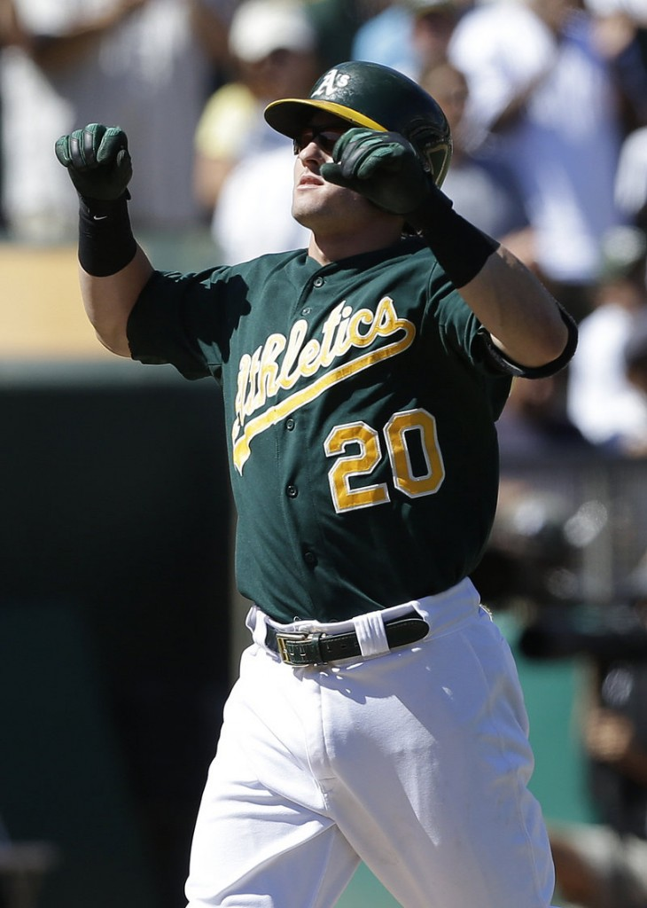 Oakland's Josh Donaldson circles the bases after his three-run homer in the sixth inning of an 11-4 win by the Athletics over the visiting Texas Rangers on Wednesday.