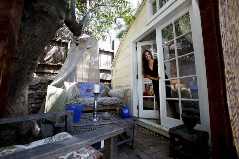 Arnold set up a patio area outside the room she rents out for guests to enjoy. Critics in her neighborhood say some Airbnb hosts are running virtual hotels that alter the community feel.