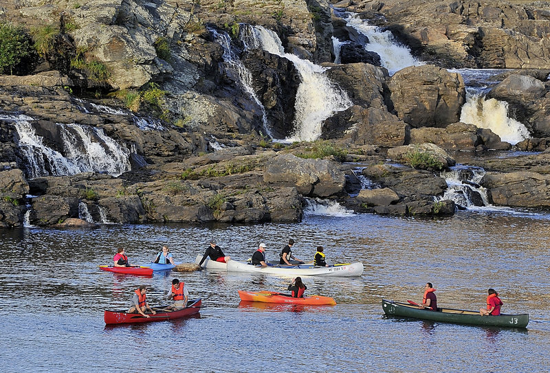 """First arrivals to the Great Falls enjoy socializing in their kayaks and canoes as they await later arrivals during the Androscoggin Land Trust's """"Paddle After Hours"""" last week, an event organized by Jonathan LaBonte, Auburn's mayor and the land trust's executive director."""