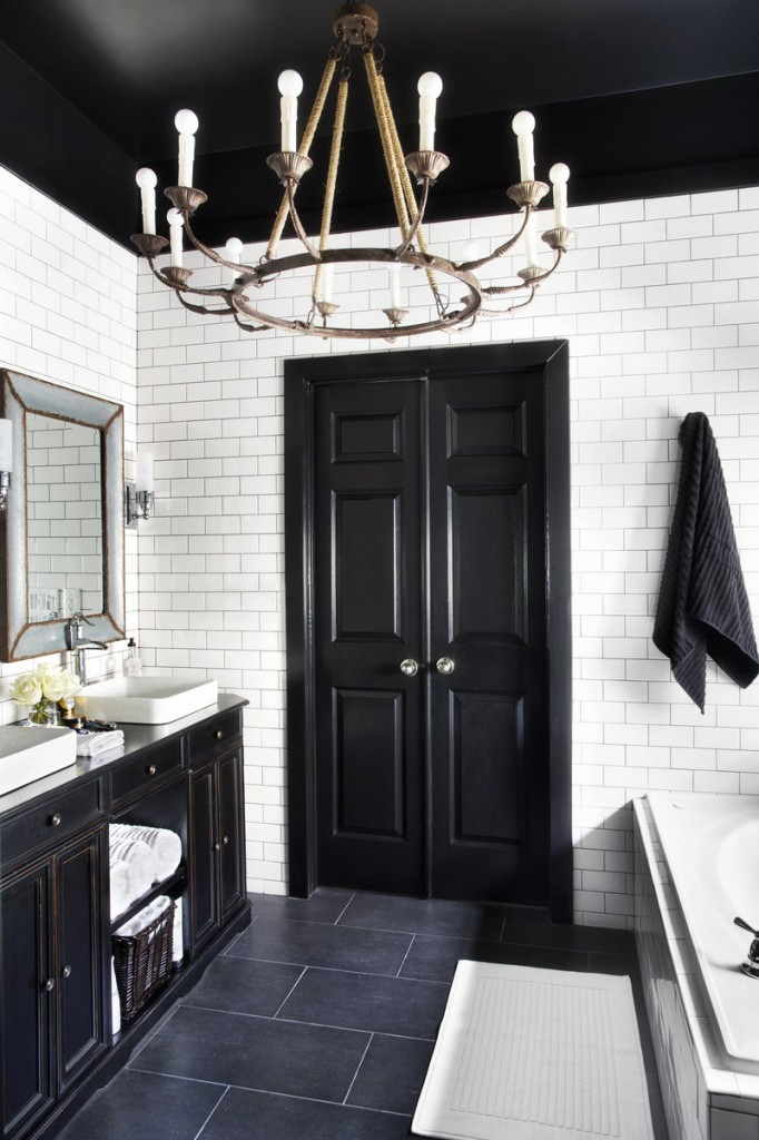 A chandelier brings a decorative and unexpected touch to a normally task-oriented space –the bathroom.