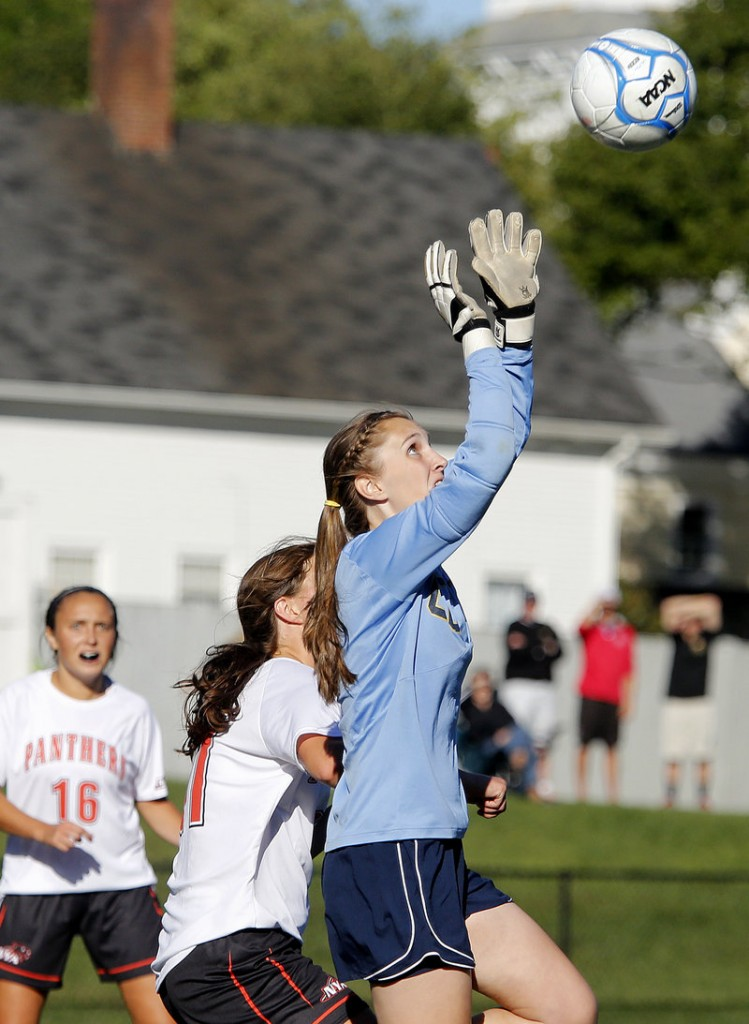 Traip Academy keeper Lynn Moore makes a save off a corner kick against North Yarmouth Academy.