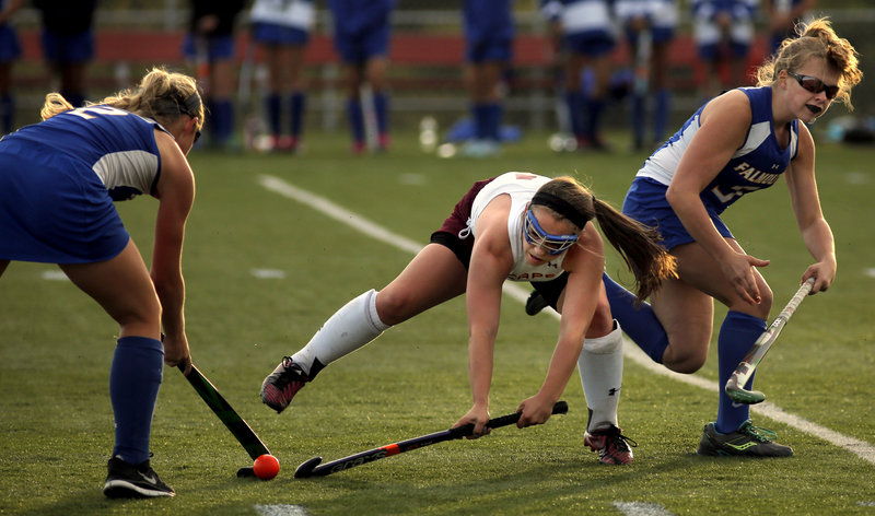 Michaela Pinette of Cape Elizabeth gets caught between Falmouth defenders Jillian Rothweiler, left, and Morgan Allen in Monday night's game at Cape Elizabeth. Falmouth won to improve to 2-0.