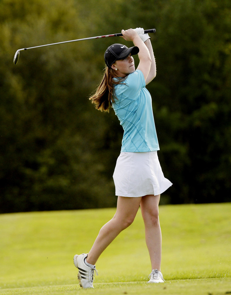 Monica Austin, Yarmouth High School's top player, watches a drive while practicing at Toddy Brook Golf Course on Monday.